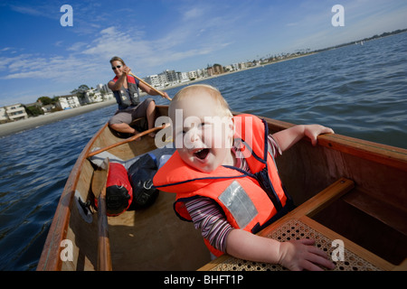 Baby girl and her mother canoeing in San Diego Bay, San Diego, California, USA - Stock Photo