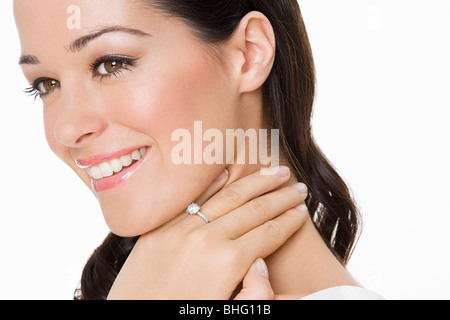 Smiling woman wearing an engagement ring - Stock Photo