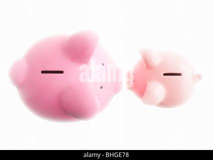 Piggy banks on white - Stockfoto