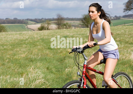 girl on bicycle in countryside - Stock Photo