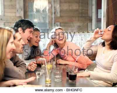 friends drinking in ski lodge bar - Stock Photo
