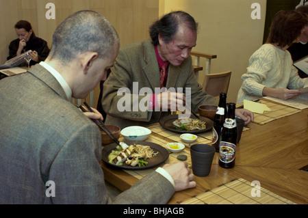 PARIS, France - Interior Japanese Restaurant, Businessmen Sharing Meals, in 'Azabu' Restaurant - Stock Photo