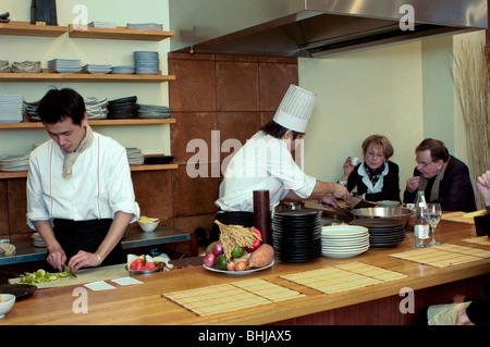 PARIS, France - Interior Japanese Restaurant, Portrait Sushi Chefs, Working in Kitchen, in 'Azabu' Restaurant - Stock Photo