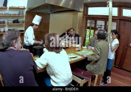 PARIS, France - Interior Japanese Restaurant, Asian Chef, Working in Kitchen, in 'Azabu' Restaurant - Stock Photo