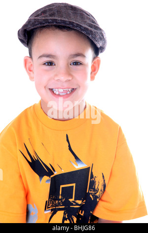Cheeky 7 year old boy wearing a cap. - Stock Photo