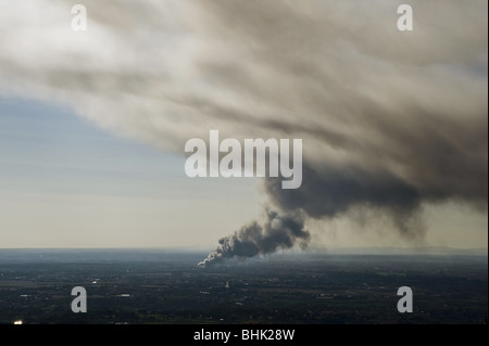 Smoke from a fire in the distance - Stock Photo