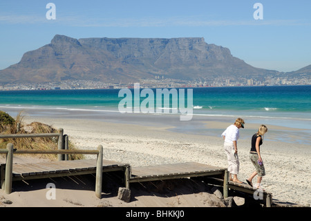 Sunset Beach & Table Bay with a backdrop of Table Mountain in Cape Town South Africa - Stock Photo