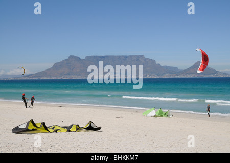 Kite surfing on Sunset Beach Table Bay and Mountain in Cape Town South Africa - Stock Photo