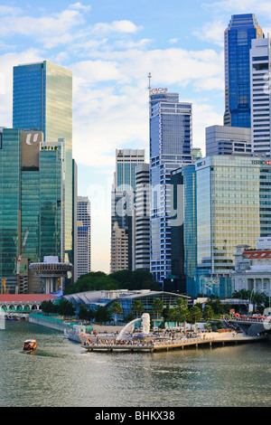 Singapore Skyline with Merlion, Fullerton Hotel and skyscraper - Stock Photo