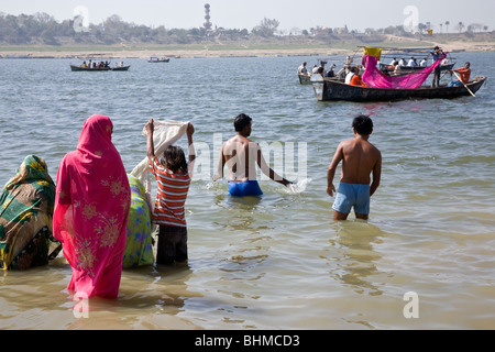 Hindu pilgrims bathing in the confluence of the Ganges and Yamuna rivers (Sangam).Allahabad.India - Stock Photo