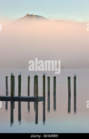 Derwent Water jetty on a misty morning, Keswick, Lake District National Park, Cumbria, England, UK. Autumn (November) - Stock Photo