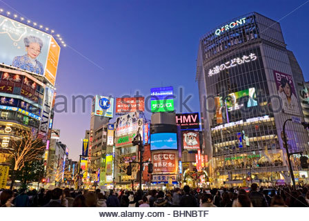 Shibuya Crossing, Hachiko Square, Tokyo Skyline, Japan, Neon Advertising Billboards. - Stock Photo
