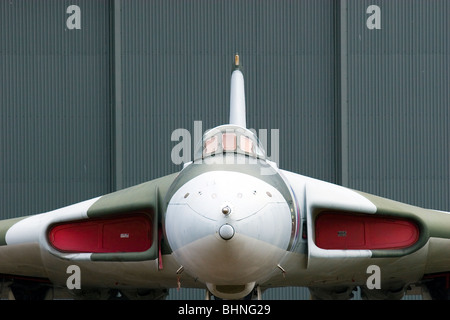 A Vulcan bomber, on display, outside a hanger at Duxford Airfield - Stock Photo