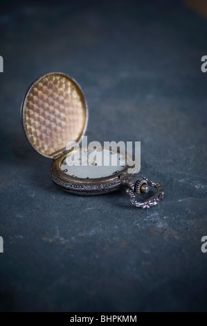 Antique pocket watch on the ground - Stock Photo