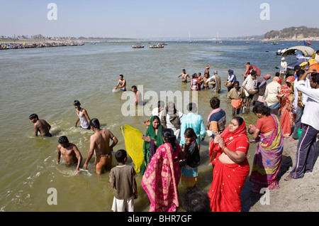 Pilgrims bathing in the confluence of the Ganges and Yamuna rivers (Sangam).Allahabad.India - Stock Photo