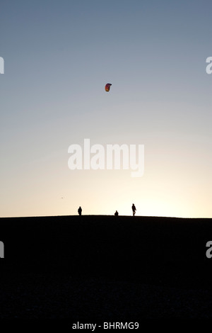 Kite flying on Chesil Beach, Weymouth, Dorset UK in the evening - Stock Photo