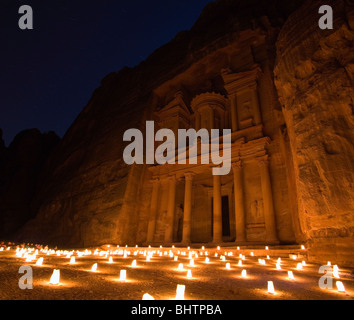 The Treasury or Al Khaznah lit up by candles for Petra by night in Wady Musa, Jordan. - Stock Photo