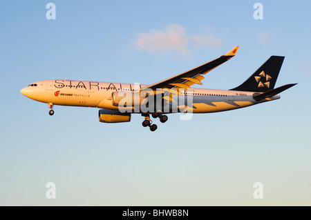 Airbus A330 operated by Star Alliance/Air China on approach for landing at London Heathrow Airport - Stock Photo