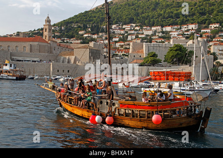 Tourist excursion ship entering old port of Dubrovnik harbour , Croatia, Europe,  - Stock Photo