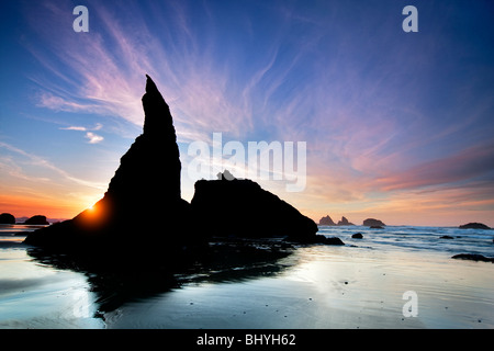 Sea stacks and sunset at Bandon Beach at low tide. Oregon - Stock Photo