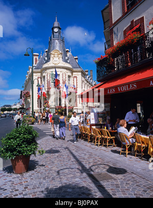 Hotel de Ville and colourful restaurant in the Channel port of Trouville - Stock Photo