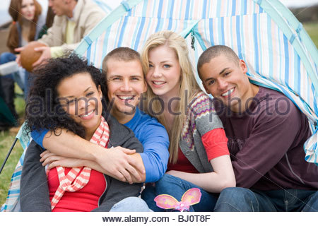 Happy couples camping in tent - Stock Photo