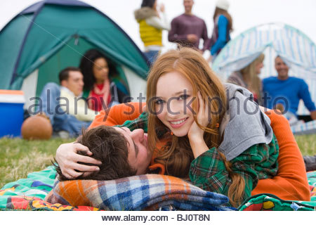 Romantic couple camping and attending outdoor festival - Stock Photo