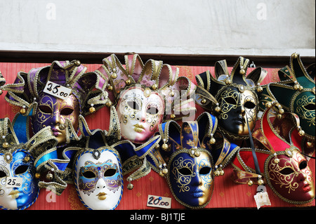Venetian masquerade masks for sale in Venice market - Stock Photo