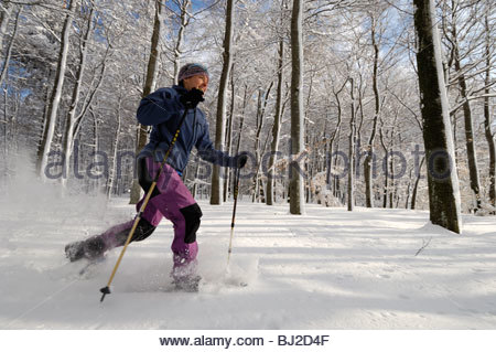 Hiker on a Snowshoe tour at the Swabian Alb. Böhringen-Römerstein; Häsel, Germany; Baden-Württemberg - Stock Photo