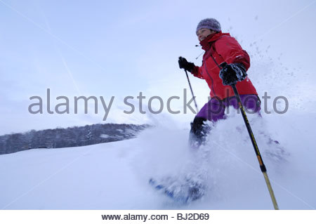 A snowshoe hiker runs through powder snow. Hiker on a Snowshoe tour at the Swabian Alb. Schopfloch, Germany; Baden - Stock Photo