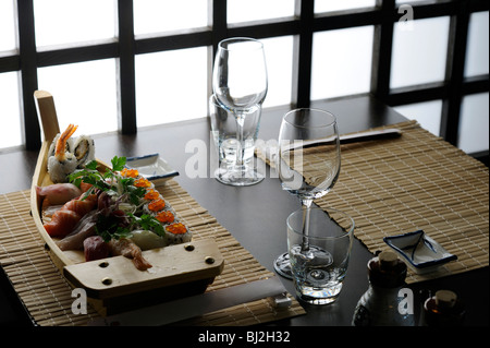 A boat of sushi in a table of elegant Japanese restaurant - Stock Photo