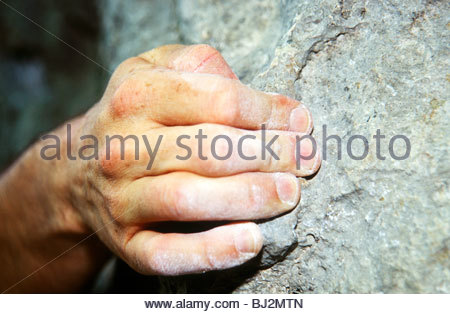 holding on to the rock - Stockfoto