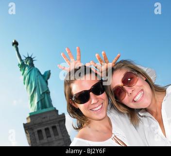 Women imitating Statue of Liberty - Stock Photo
