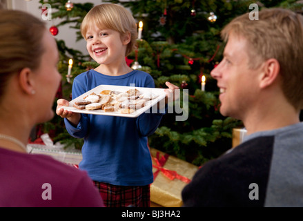 boy presents plate of homemade biscuits - Stock Photo