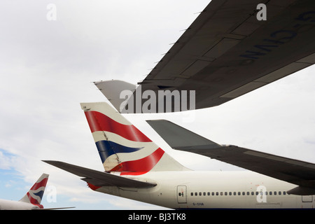 Wing tips and tails from British Airways 747-400 jet airliners are almost touching during their respective turnarounds. - Stock Photo