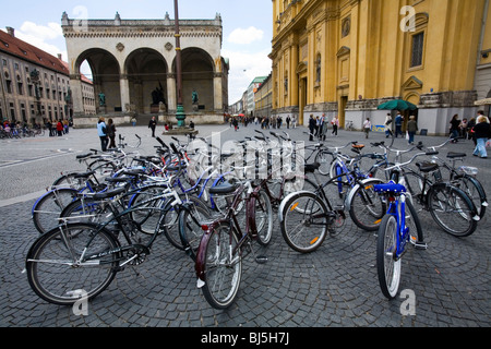 Bicycles in front of Odeonplatz Feldherrnhalle and Theatinerkirche Munich, Germany - Stock Photo
