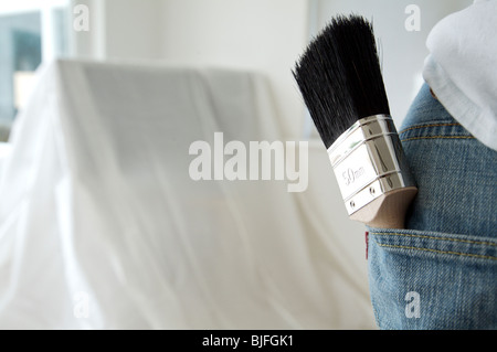 Close up of brush in man's pocket - Stock Photo