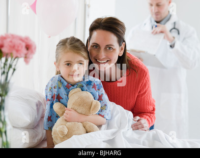 Mother and daughter in hospital - Stock Photo