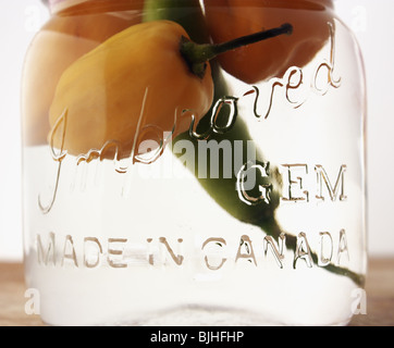 Hot peppers in mason jar - Stock Photo
