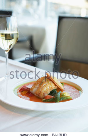 Fried black cod on vegetables and red pepper sauce - Stockfoto