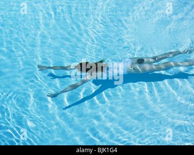 Woman swimming in pool - Stock Photo
