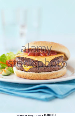 A double cheeseburger with tomato salsa - Stock Photo