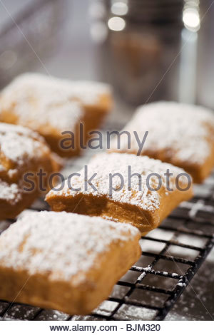 Beignets Topped with Powdered Sugar on a Cooling Rack - Stockfoto