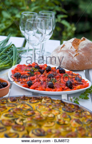 Baked peppers with olives and courgette bake - Stock Photo