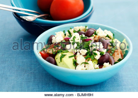 Chicken, olive and feta salad with parsley - Stock Photo