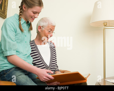 Grandmother and granddaughter reading - Stock Photo