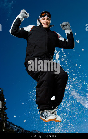 Man jumping outside in the snow - Stock Photo