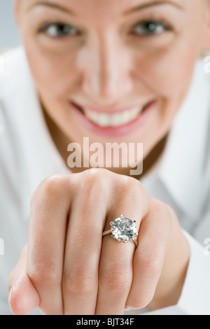 A woman wearing an engagement ring - Stock Photo