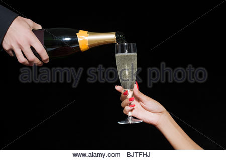 Champagne being poured - Stock Photo