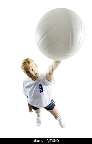 Volleyball player with ball making hand gesture - Stockfoto